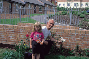 Grandfather and granddughter in the garden
