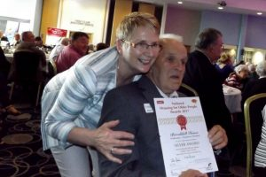 Fred Crawford tenant at Brookhill House with Support worker Patricia Mullan receiving the Silver award for Brookhill House