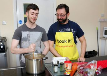 "Strand Foyer ""Cook It"" tutor Stephen Kerr with Strand Foyer resident Sean Doherty prepare Irish stew"
