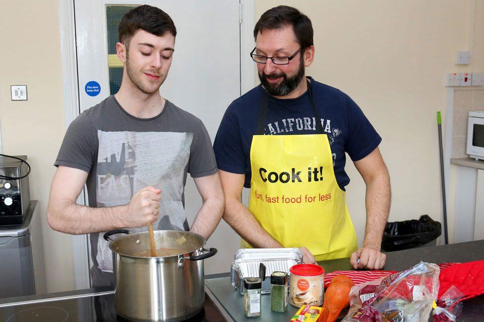 "Strand Foyer ""Cook It"" tutor Stephen Kerr with Strand Foyer resident Sean Doherty prepare Irish stew"