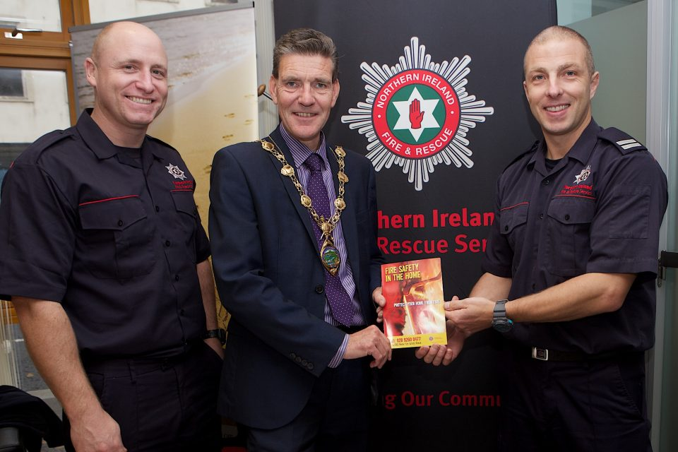 Mayor John Boyle at the Apex Older Persons Day held in Holywell Trust, with members of the NI Fire & Rescue Service, Gerry Tracey and on left Bryan McCaul