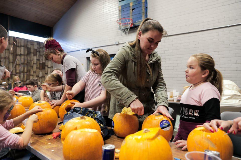 Everyone enjoying carving their pumpkins.