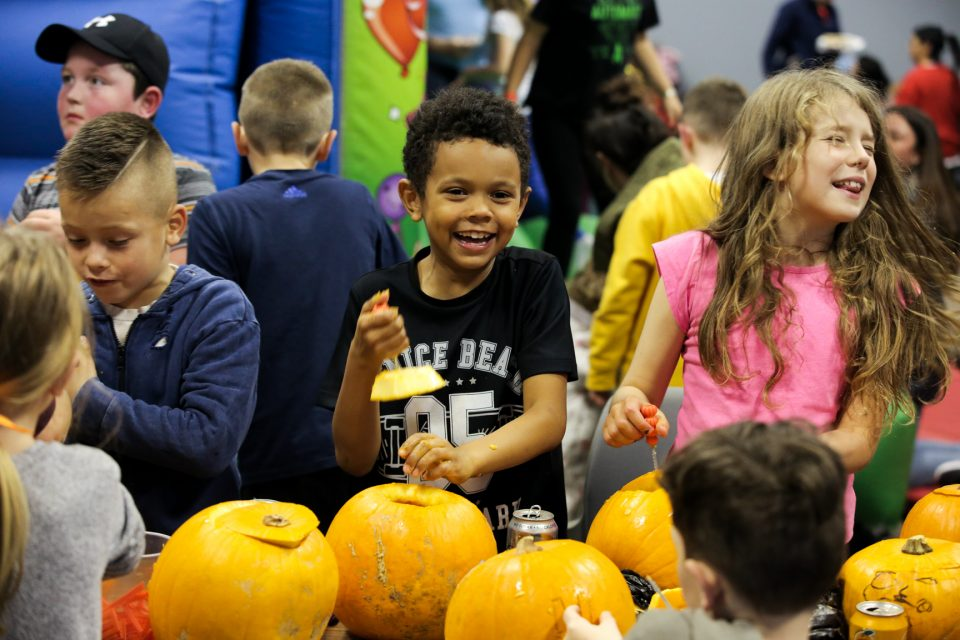 Young people getting stuck into their pumpkins.