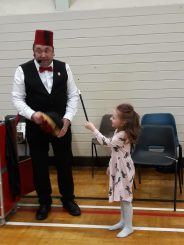 6 year old Kayla Green assisting Parky the Magician.