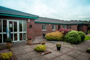 Patio leading to rear courtyard and garden