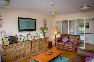 Common room with large television and pool table