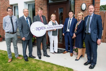 Pictured at the official opening of a new social housing scheme in Culcavy are L-R: Eoin McKinney, NIHE, Gerry Kelly, Apex, DSD Minister Mervyn Storey MLA, Marion Johnston, tenant, Keelan McGrahran, Apex, Jacqui Gilmore, Apex, Peter Moran, Todd Architects