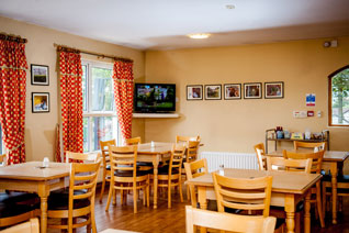 House in the Wells dining room with television