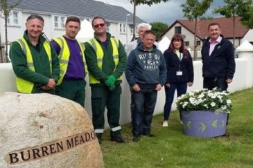 Burren Meadows residents and council staff with the new planters